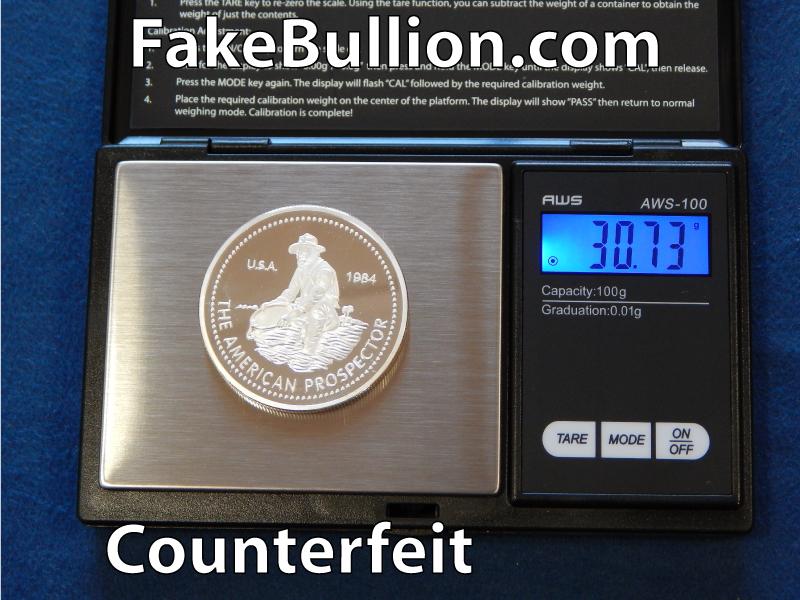 weighing counterfeit silver round