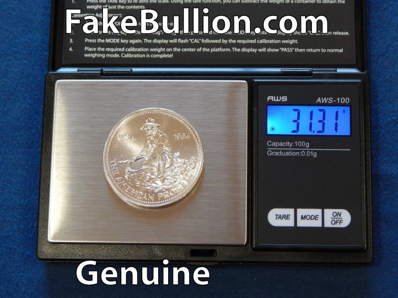 weighing genuine silver round